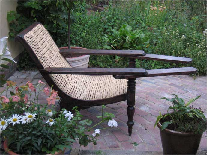 This image shows a side view of a Tea Planter chair