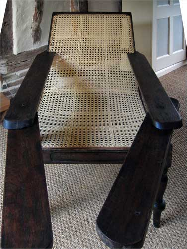 This image shows a front view of a Tea Planter chair