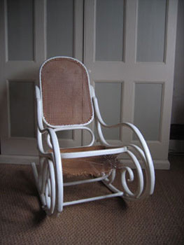 This picture is of the Thonet rocking chair when it first arrived, tatty and covered in paint with the seat hanging down.