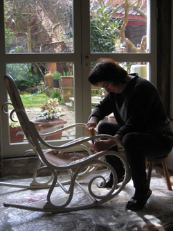 This picture shows Sue at work on the Thonet chair, removing the original tatty cane.