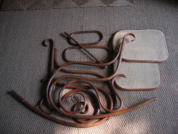 This picture shows the Thonet chair in pieces on the floor, having been stripped, recaned and polished.